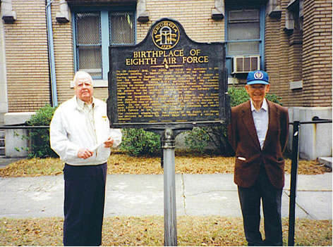 two elderly men with plaque that reads Birthplace of the Eighth Air Force